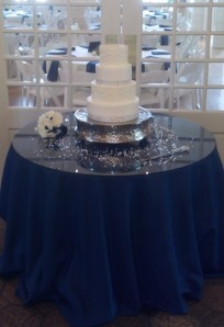 Crystals decorate the layers of this stunning Wedding cake as well as the top of the table.