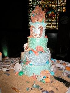 "Sugar ""Wet"" Sandcastle & seahorses sugar ""sand"" finish this beach wedding cake"