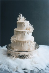 "Frosted Italian Buttercream ""icicles"" and fake snow finish this winter wedding cake"